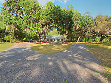Photo: Driveway and Front Yard